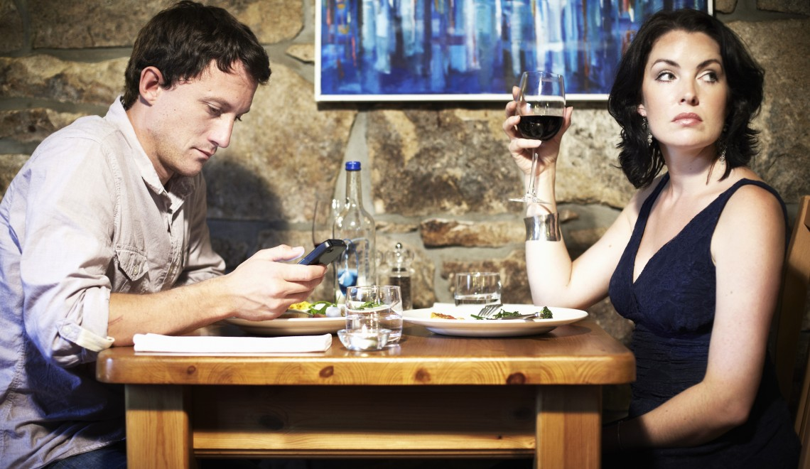 Bored couple having dinner in restaurant